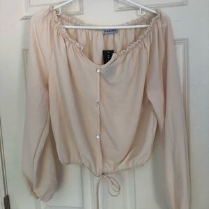 cream colored off the shoulder top